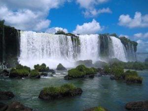 Photo of Iguazu Falls with blue sky background