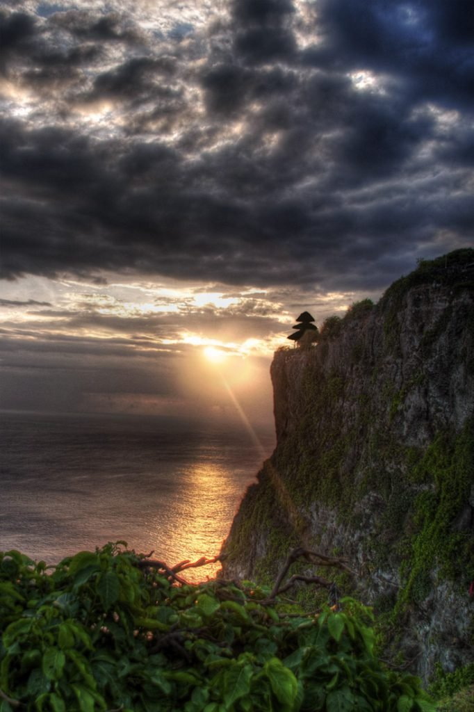 sunset over Uluwatu temple in Bali, Indonesia