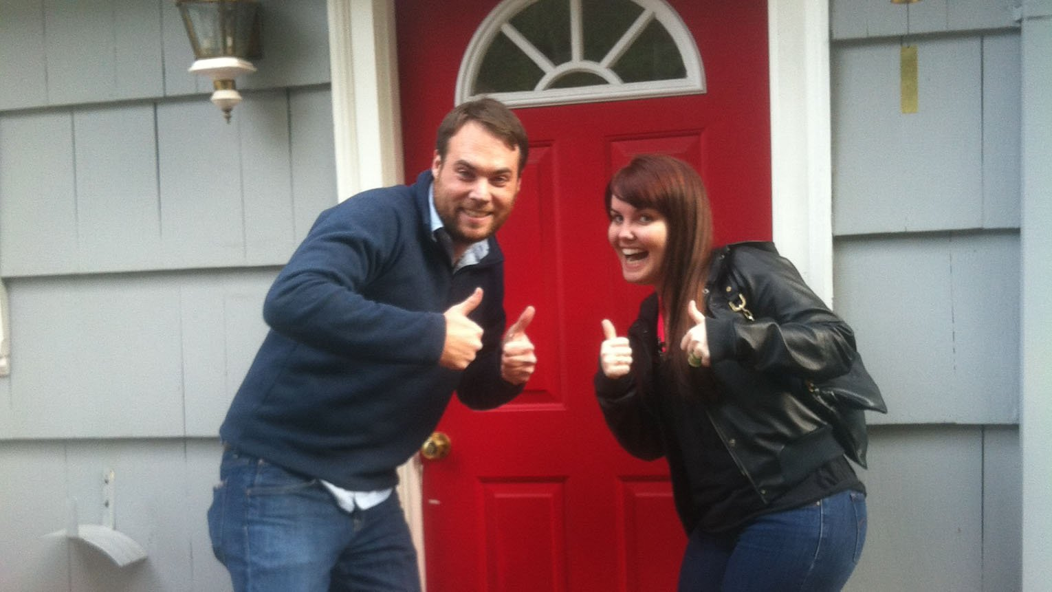 In front of our new house - 30 seconds before I proposed.